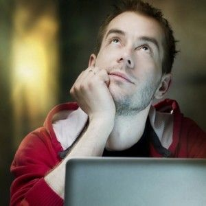 Man On Laptop Thinking Looking Above