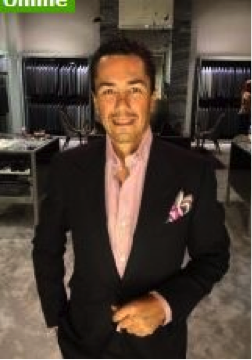 Picture of guy who looks stylish and affluent on Travelgirls website.