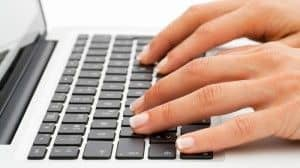 Online dating secretary typing on computer.